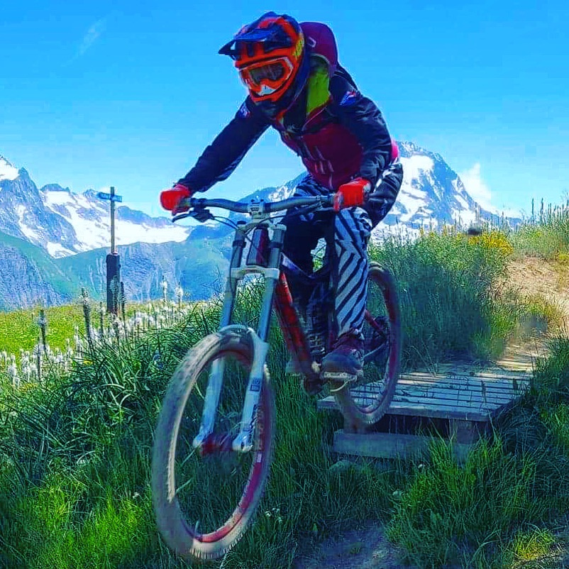 Alex jumping on her bike in Les Deux Alpes